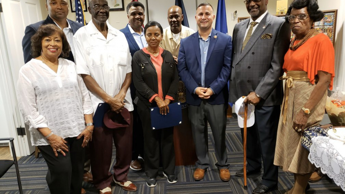 Rep. Soto posing with a group of community leaders